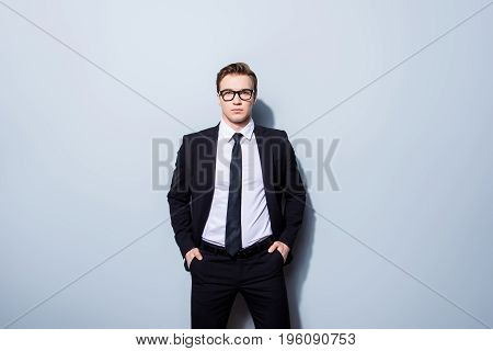 Success Concept. Stylish Young Lawyer Man, Standing On Pure Background, Wearing Black Suit, Tie, Loo