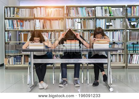 Young Student Group Reading Book Serious Hard Exam Quiz Test Sleeping headache worry in Classroom Education Library University Knowledge center