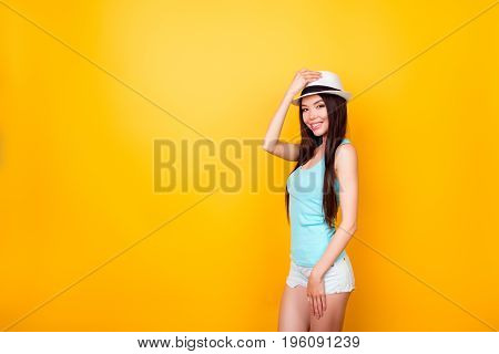 Young Cute Korean Lady In Summer Outfit Standing In Pose On Bright Yellow Background. She Is So Skin