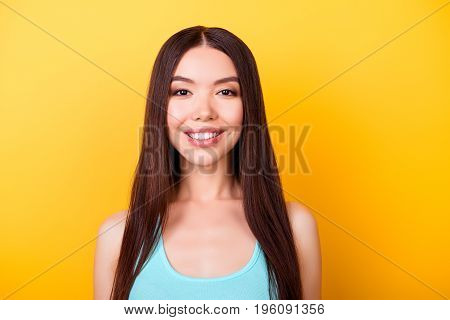 Close Up Portrait Of Young Charming Asian Lady, Standing On The Yellow Background And Smiling, Weari