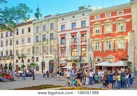 LVIV, UKRAINE - July 16, 2017: Lviv city landscape. Lviv old town with people. Central square in Lviv. The area the market.