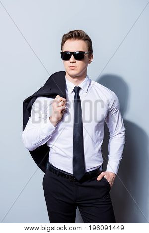Harsh Agent, Standing On A Pure Background. He Looks Stunning And Severe, Wearing Formal Clothes And
