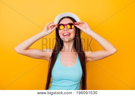 Happy Young Asian Girl On Summer Vacation. She Is In A Stylish Hat, Trendy Sun Glasses, Wearing Casu