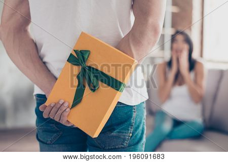 Have Something For You, Dear!  Focus On A Yellow Gift Box, Shocked Brunette Girlfriend On Background
