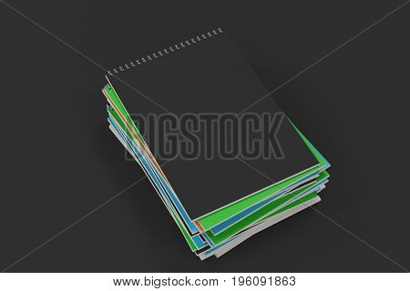 Stack Of Multicolored Notebooks With Metal Spiral Bound On Black Background