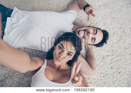 Cheerful Playful Ltino Mulatto Sister And Brother Are Taking Selfie And Making Funny Grimaces, Gestu