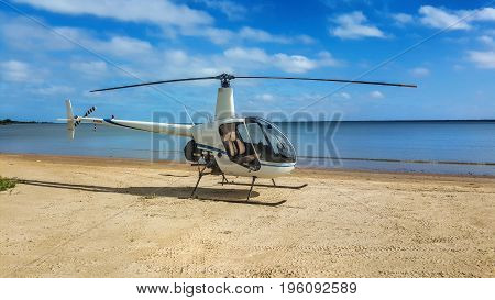 helicopter on the beach on a sunny day at Weipa