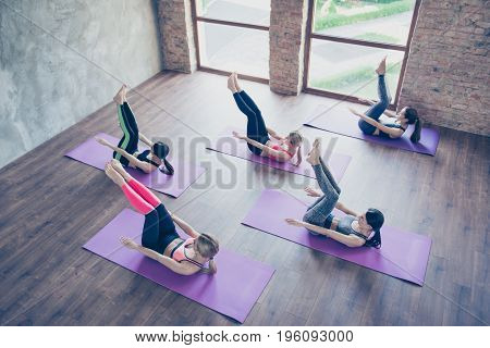 Top Up Of Abs Work Out. Five Concentrated Sporty Girls Are Training Their Abs, Wearing Modern Sport