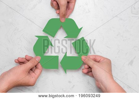 Eco Concept. Paper Recycle Sign In Hands