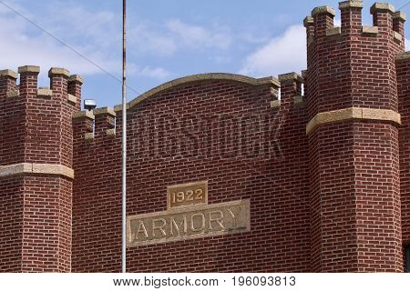 The former historic armory with a flag pole