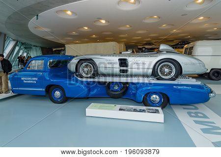 STUTTGART GERMANY- MARCH 19 2016: The high-speed racing car transporter Mercedes-Benz (Blue Wonder) and racing sports car Mercedes-Benz 300 SLR on the trailer 1955. Mercedes-Benz Museum.