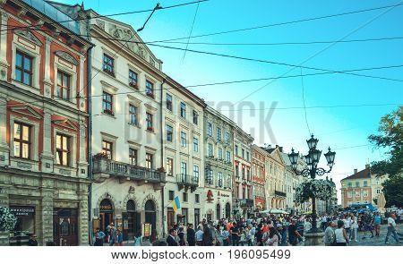 LVIV, UKRAINE - July 16, 2017: Lviv city landscape. Lviv old town with people. Colorful historical street