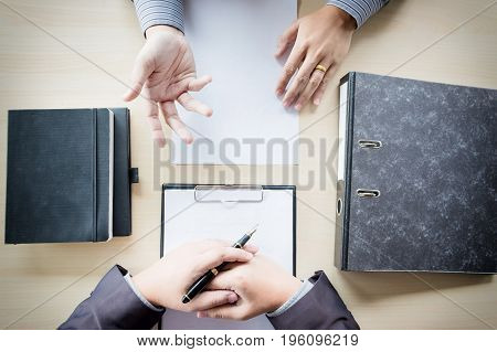 Top View Of Businessman Conducting An Interview With Businessman In An Office