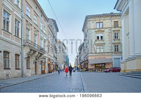 Lviv,Ukraine - JULY 16, 2017: Old part of Lviv. Medieval architecture of the Central European cities. Old European city Lviv. Cobbled Lviv street with tram tracks