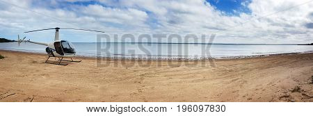helicopter on the beach panoroma at Weipa