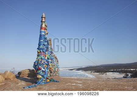 Columns With Colorful Ribbons On Cape Burhan. Lake Baikal Landscape