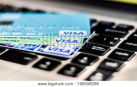 BANGKOK THAILAND - JULY 21 2017: closeup shot of credit card issued by VISA on computer keyboard