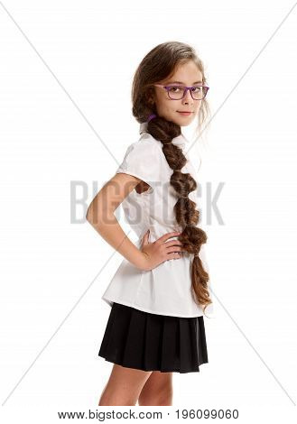 Portrait of young smart serious schoolgirl wearing glasses