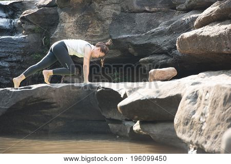 Yoga With Asian Tall Women Wear White Robes On Rocks In Forests, And Mountains With Beautiful Waterf