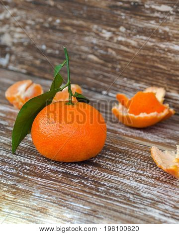 Whole Mandarin With Green Leaves And Mandarin Slices On Wood Table. Organic Tangerines Fruit Backgro