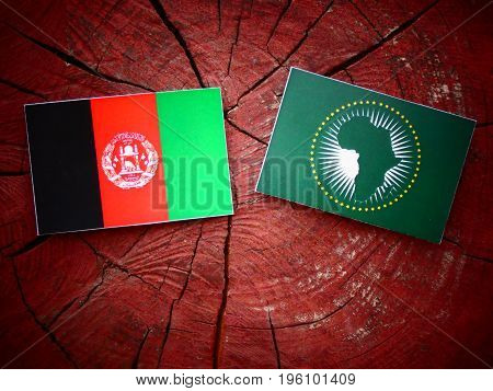 Afghani Flag With African Union Flag On A Tree Stump Isolated