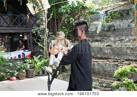 Bangkok THAILAND - July 14 2017: Puppet of Hanuman in Ramakien or Ramayana Story with Puppeteer wear the black mask in klong bang luang floating market in Bangkok Thailand