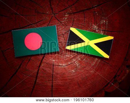 Bangladesh Flag With Jamaican Flag On A Tree Stump Isolated