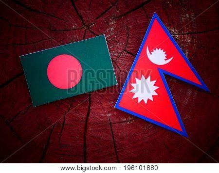 Bangladesh Flag With Nepali Flag On A Tree Stump Isolated