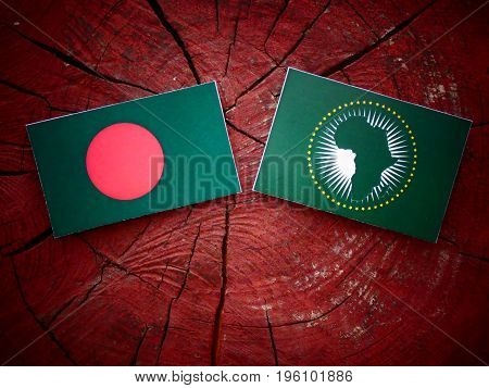 Bangladesh Flag With African Union Flag On A Tree Stump Isolated