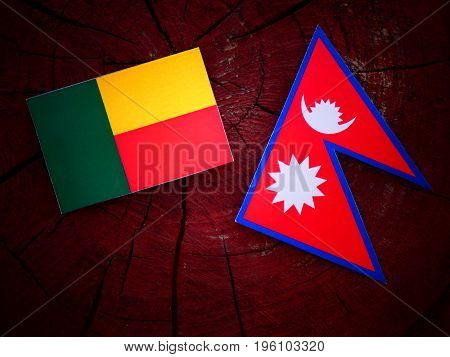 Benin Flag With Nepali Flag On A Tree Stump Isolated