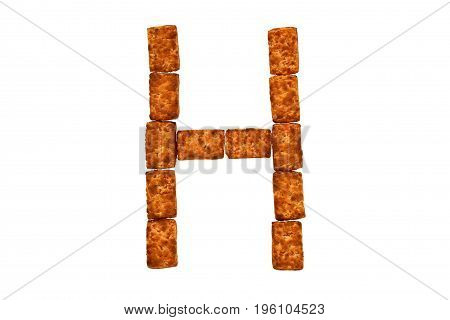 Alphabet made up of cookies on a white isolated background. letter H
