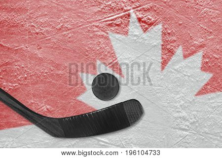 Hockey puck putter and image of the Canadian symbol on ice. Concept hockey