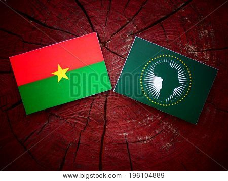 Burkina Faso Flag With African Union Flag On A Tree Stump Isolated