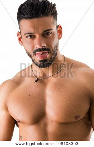 Young handsome shirtless muscular man with tongue out showing the piercing isolated on white.