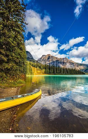 In shallow moored boat. The concept of eco-tourism and active tourism. The mountain Emerald lake.  Sunny day in autumn Yoho National Park