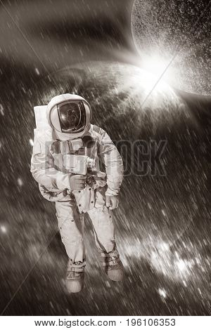 Astronaut wearing pressure suit in a space background, vintage filter style