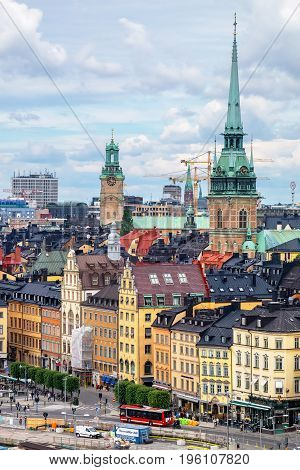STOCKHOLM SWEDEN - JULY 08 2017: Spires of German Church (Tyska Kyrkan) and Stockholm Cathedral (Storkyrkan) rises above the rooftops of the Gamla Stan