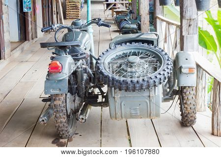 BANGKOK THAILAND - JULY 14 : vintage retro military motorcycle with side car army transport on wooden floor in gallery on July 14 2017 in Bangkok Thailand