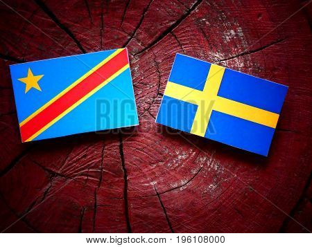 Democratic Republic Of The Congo Flag With Swedish Flag On A Tree Stump Isolated