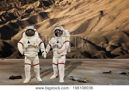 Astronaut Wearing Spacesuit in a sand dune Background