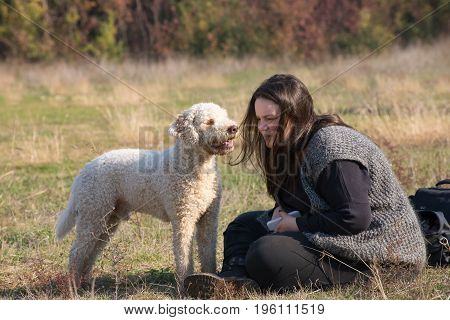 Girl and her dog during a obedience traiing