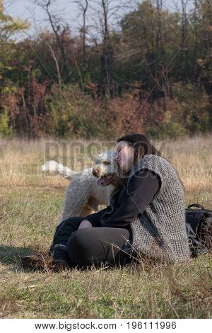 The girl explains something to her dog during a obedience training