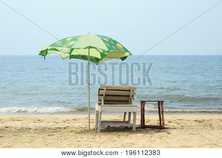 Chair with Umbrella near the tropical Beach