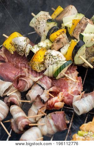 barbecue with delicious grilled meat and vegetable on grill