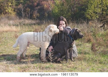 Girl and her dogs during a training