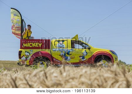 Saint-Quentin-Fallavier France - July 16 2016: Le Journal du Mickey car during the passing of Publicity Caravan in a wheat plain in the stage 14 of Tour de France 2016.