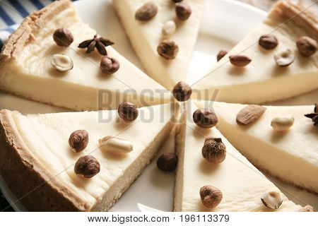 Delicious sliced cheesecake with nuts, closeup