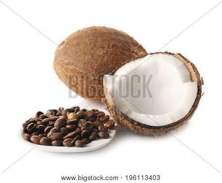 Saucer with coffee beans and coconuts on white background