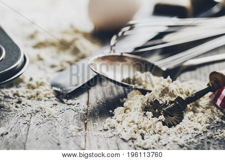 Baking concept kitchen cooking cutlery accessories for baking on wooden background with flour. Top View. Cooking Process. Nobody.
