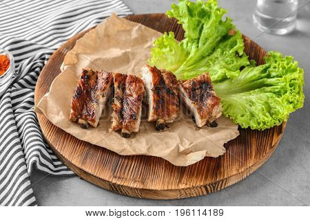 Yummy grilled sliced spare ribs on wooden plate